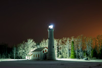 Snowy Sturgeon Point Lighthouse at Night